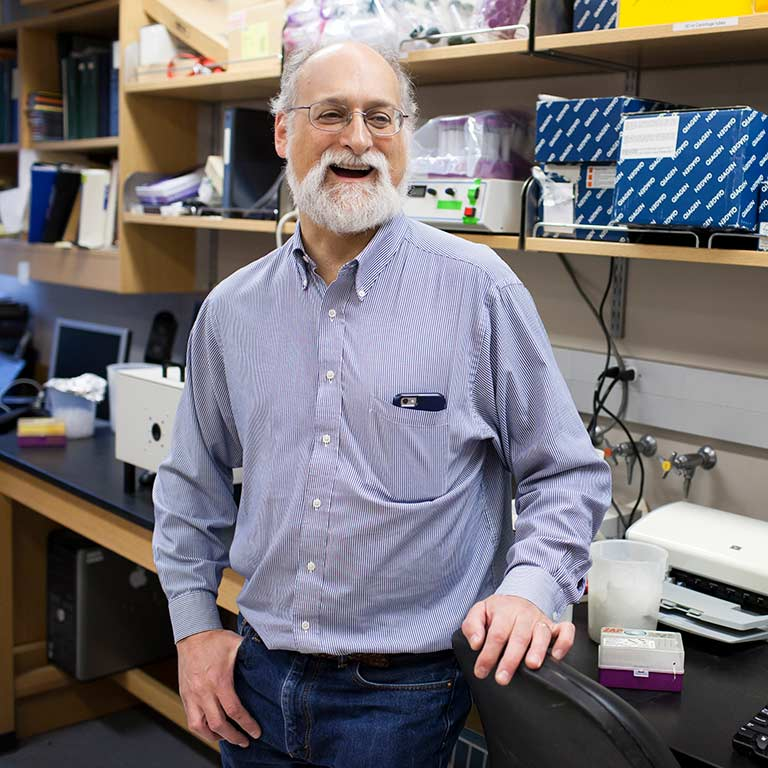 IU faculty member Adam Zlotnick in his lab
